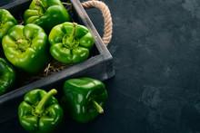 Fresh Green Pepper In A Wooden...