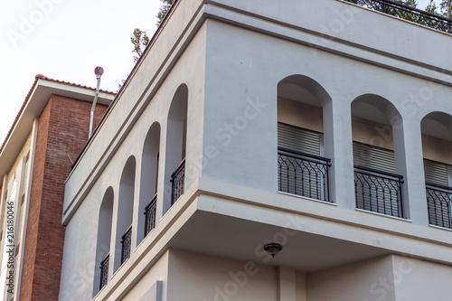 Foto auf AluDibond Gezeichnet Straßenkaffee Perspective 2-storey building gray colored facade corner at Lesvos in Aegean region