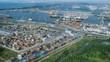 Trans-Atlantic transport .Transport company .Containers unloading / loading. Huge marine center. Docks. Shipyard. A huge logistics port. Transport node. Aerial shot. 4K.