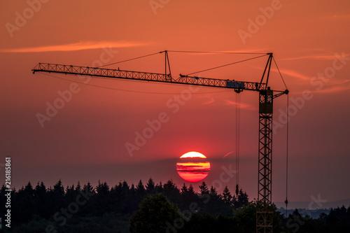 Foto auf AluDibond Ziegel Neubaugebiet bei Sonnenuntergang