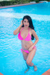 Portrait of asian sexy woman at swimming pool,Thailand has a slim body shape,Healthy woman concept,Fashion bikini summer