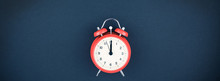 Red Vintage Alarm Clock On Dark Background