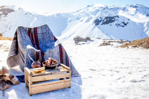 Платно Winter picnic in chilean argentine snow mountaines Andes with hot meat food and drink yerba mate