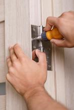 Screwdriver Installs Door Hinges