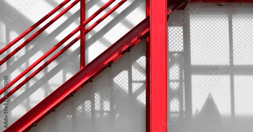 Canvas-taulu red fire escape staircase with shadow