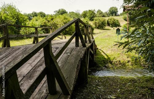 Keuken foto achterwand Old oak wooden bridge and green meadow