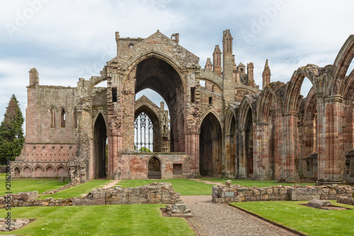 Vászonkép View at wall and ruins of Melrose abbey in Scottish borders