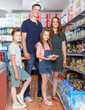 Portrait of family their kids with meal for home in the grocery shop