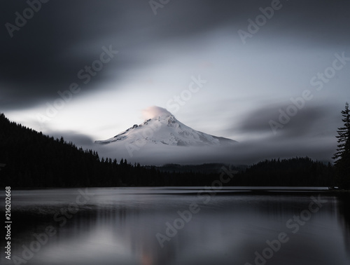 Aluminium Prints Mt Hood reflecting of Trillium lake at sunset. The last shards of light striking the clouds above its peek.