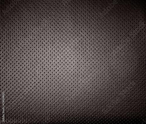 Valokuva  Perforated dark leather, textured background, design element