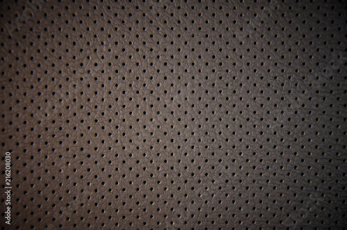 Valokuvatapetti Perforated dark leather, textured background close-up, design element