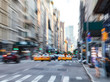 Fast moving taxis on Fifth Avenue in Manhattan New York City blurred background