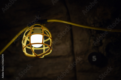 Yellow lamp in underground cave or mine.