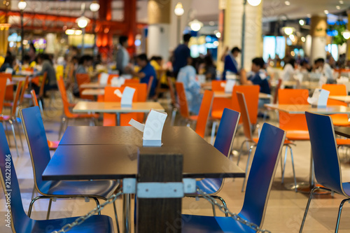 Tables and chairs on food court