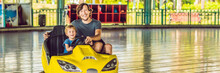 Father And Son Having A Ride In The Bumper Car At The Amusement Park BANNER, Long Format