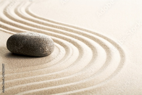 Staande foto Stenen in het Zand Zen stones in the sand. Grey background