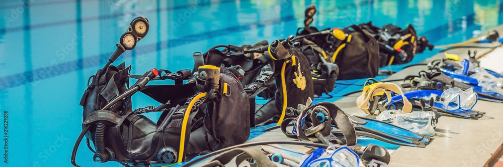 Fototapeta Equipment for diving is on the edge of the pool, ready for a lesson BANNER, long format