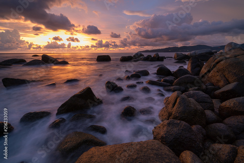 landscape long exposure Sunset beach and sea rock Poster