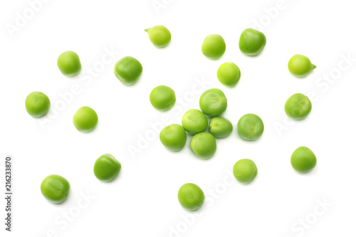 Leinwand Poster fresh green peas isolated on a white background. top view