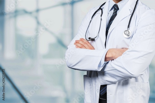 Young man doctor holding stethoscope Wallpaper Mural