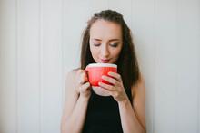 A Girl Holds A Big Mug Of Tea