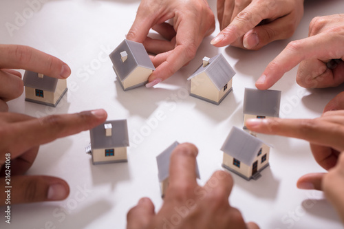 Group Of People Touching Miniature House Wallpaper Mural