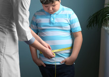 Doctor Measuring Overweight Bo...