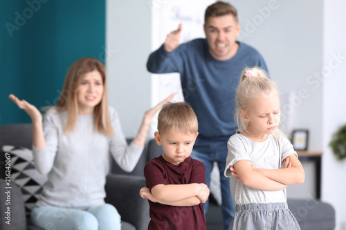 Stampa su Tela Parents scolding their children at home. Family conflict