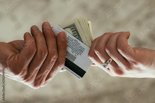 Financial And Accounting Fraud Illegal Money Withdrawal Tax Dodging Two Pairs Of Hands Exchanging Electronic Currency For Cash