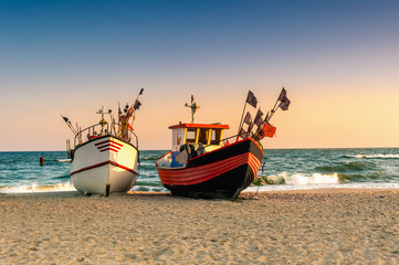 Fototapeta Do biura Fishing boat parked on the beach