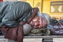Homeless Male Sleeping On Ston...