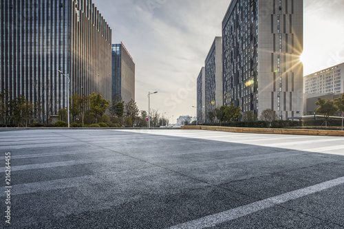 Fototapeta Panoramic skyline and modern business office buildings with empty road,empty con