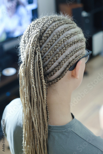 beauty services, a lot of thin color braids on the head