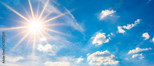 Hot summer or heat wave background, blue sky with glowing sun