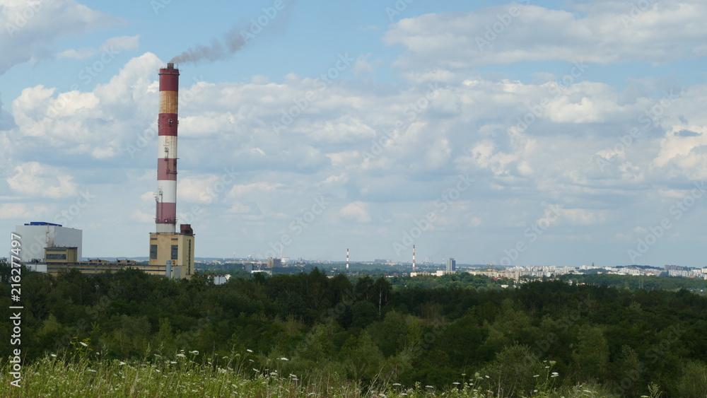 Fototapeta Zanieczyszczenie powietrza. Komin ciepłowniczy na terenie Śląska w okolicy Katowic