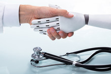 Doctor And Robot Shaking Hands
