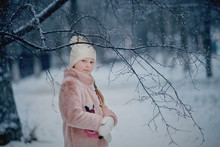 Girl Playing In A Snow Park In A Fur Coat