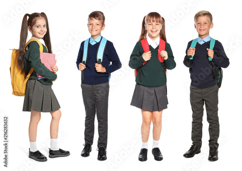 Cute school children in uniform with backpacks on white background Fototapete
