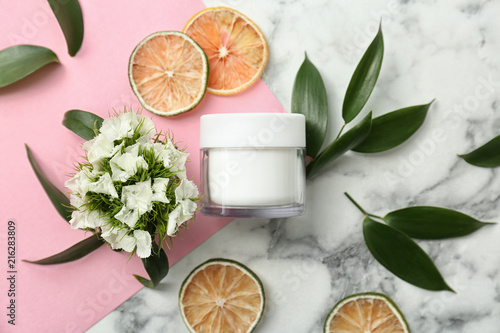 Beautiful composition with jar of cream on colorful background, flat lay