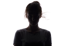 Silhouette Of A Serious And Confident Young Woman Looking Straigh On A White Isolated Background