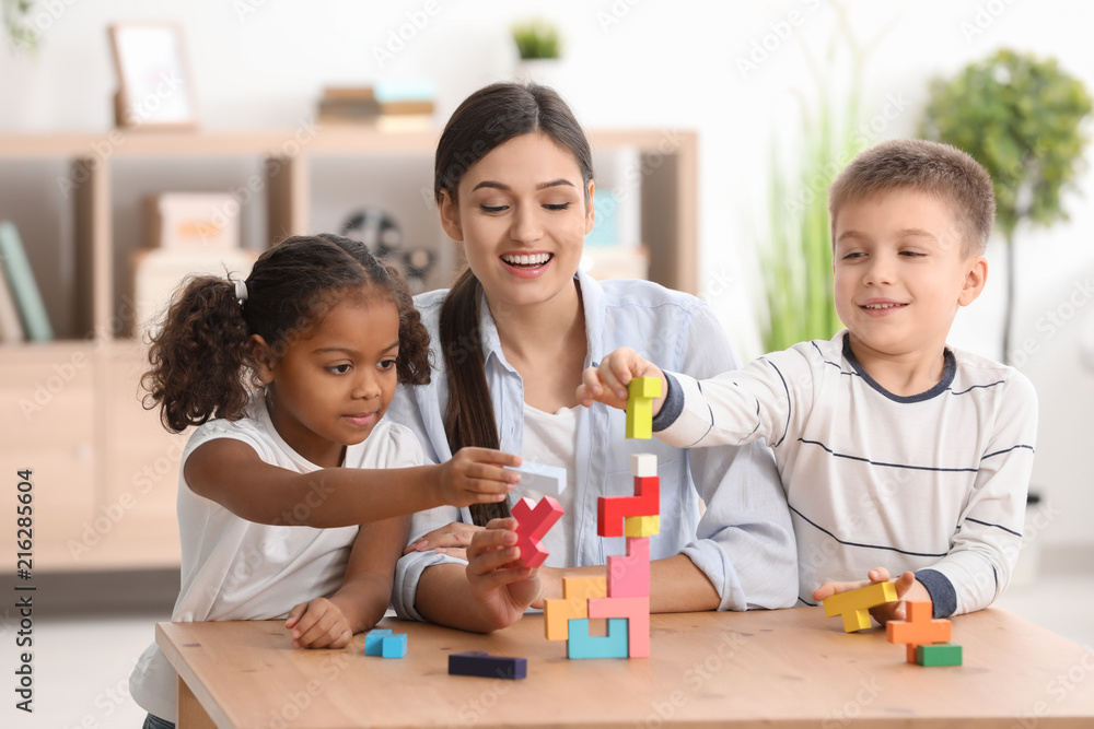 Fototapety, obrazy: Young woman playing with little kids indoors. Child adoption