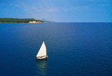 top view of the sailboat in the sea