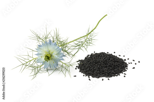 Heap of black nigella seeds and flower