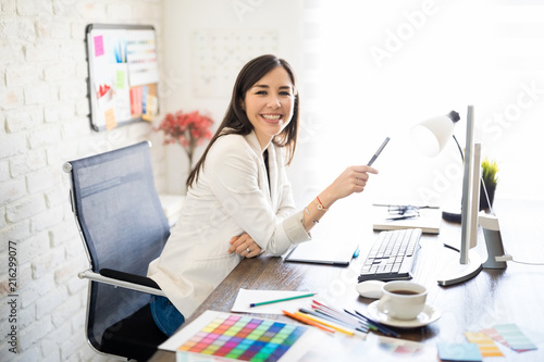 Woman graphic designer in her office