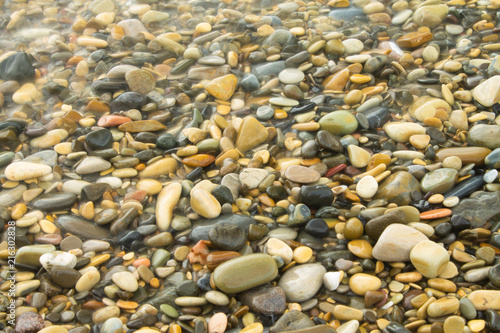 Photographie  stones under water at long exposure