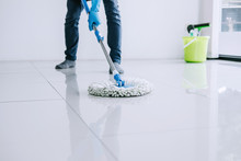 Husband Housekeeping And Cleaning Concept, Happy Young Man In Blue Rubber Gloves Wiping Dust Using Mop While Cleaning On Floor At Home