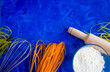 Leinwanddruck Bild - Food background, ingredients for cooking. Pasta spaghetti, vegetables, blue stone background copy space view from above