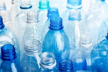 Plastic Bottles Of Water On Background