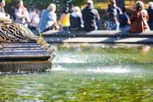 Fountain Closeup Large Splashing Water In Urban City Park Green Droplets Drops