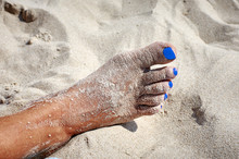 Foot Of A Woman On The Beach